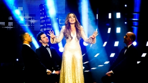 Gina Dirawi will present 3 live hour long shows before the Eurovision Semi Finals and Grand Final