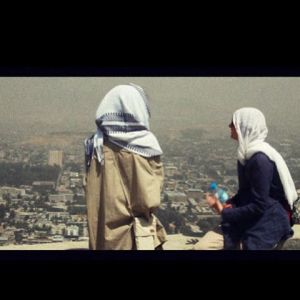 Loreen looks down on Kabul from the top of Teve Mountain. Photograph courtesy of Loreen Facebook