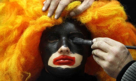 A woman's face is painted to become a Black Pete in Soest in the Netherlands. Photograph: Bas Czerwinski/EPA