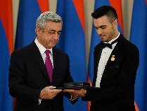 Andre receiving Armenia Artist of Honour from President Serzh Sargsyan. Photo Andre Mgt