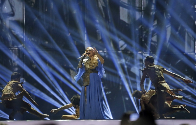 Singer Cristina Scarlat representing Moldova performs the song 'Wild Soul', during the first semifinal of the Eurovision Song Contest in the B&W Halls, in Copenhagen, Denmark, Tuesday, May 6, 2014. (AP Photo/Frank Augstein)